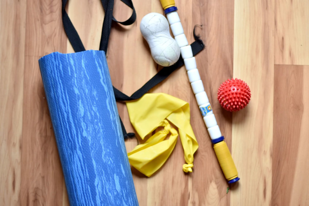 Recovery Kit including foam roller, strap, lacrosse balls stretchy bands and stick. [Photo] Erika Flowers